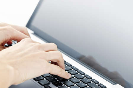 use computer: Hands typing on laptop computer keyboard close up Stock Photo