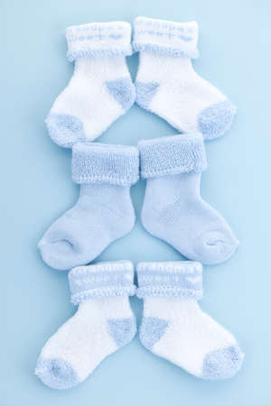 Arrangement of three pairs of blue infant boy socks for baby shower photo