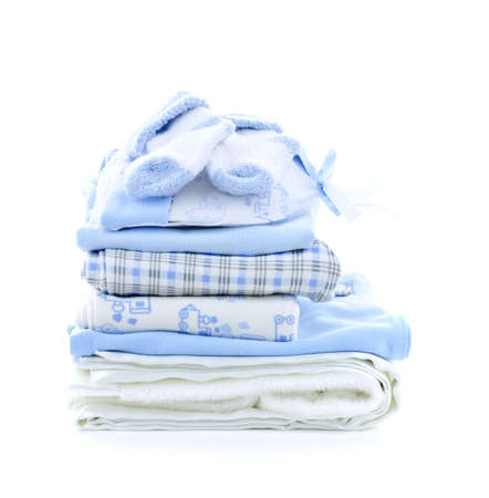 Stack of blue infant clothing for baby shower isolated on white background photo