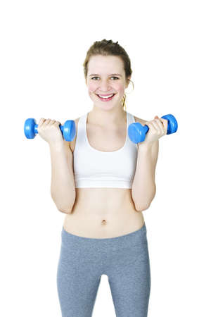 Happy fit young woman working out with weights on white background photo