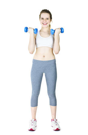 Happy fit young woman working out with weights standing on white background photo