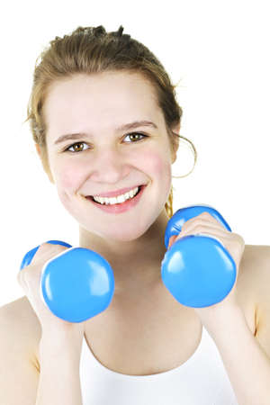 Portrait of smiling fit young woman working out with weights for fitness exercise photo