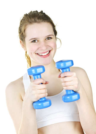 Happy fit young woman working out with weights for fitness exercise photo