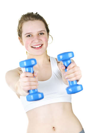 Healthy young woman working out with weights for fitness exercise photo