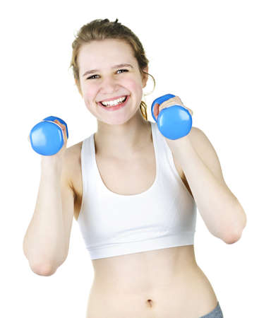 Happy smiling young woman working out with weights for fitness exercise photo