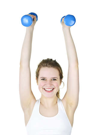 Happy healthy fit young woman lifting weights for fitness exercise photo