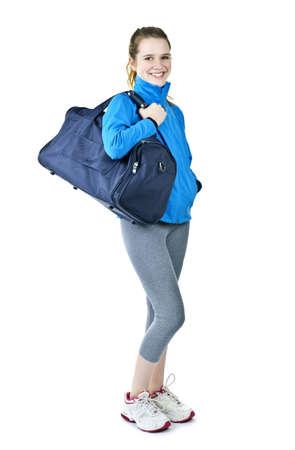 Gelukkig fit jonge vrouw met sporttas staan klaar voor de fitness-oefening Stockfoto