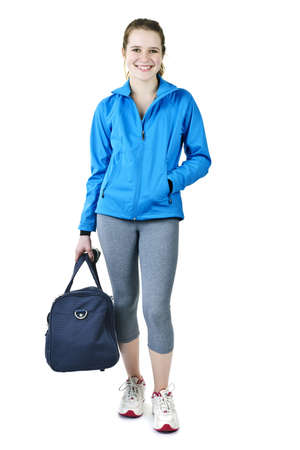 body bag: Smiling fit young woman with gym bag standing ready for fitness exercise Stock Photo