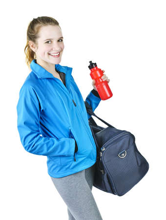 Smiling fit young woman with gym bag and water bottle ready for fitness exercise photo