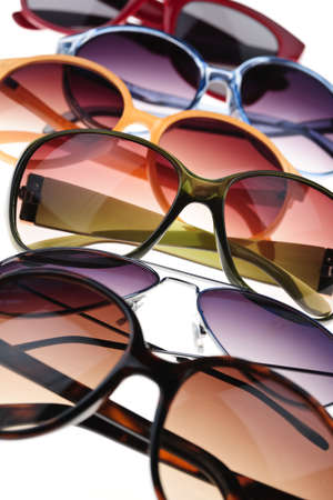 tinted: Assorted styles of tinted sunglasses on white background close up