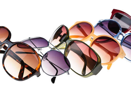Different styles of tinted sunglasses on white background Stock Photo - 9559356