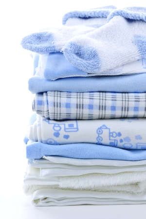 Stack of blue infant clothing for baby shower photo