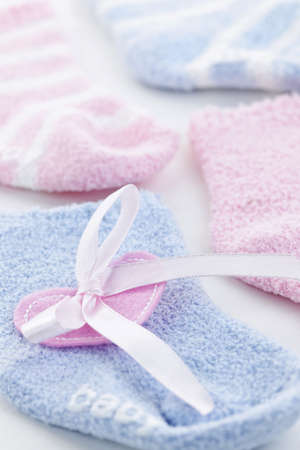 Pink and blue infant socks for baby shower with ribbon photo