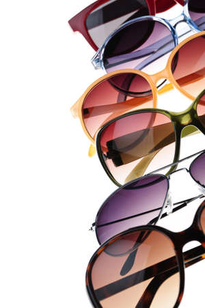fashionable sunglasses: Different styles of tinted sunglasses on white background Stock Photo
