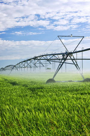 Industrial irrigation equipment on farm field in Saskatchewan, Canada Stok Fotoğraf