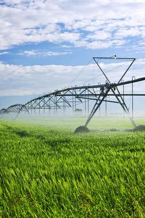 spraying: Industrial irrigation equipment on farm field in Saskatchewan, Canada Stock Photo
