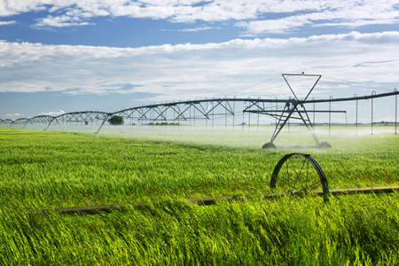 equipment: Industrial irrigation equipment on farm field in Saskatchewan, Canada Stock Photo