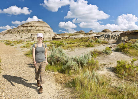 Happy girl hiking the Badlands in Dinosaur provincial park, Alberta, Canada photo