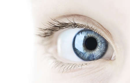 sight: Female blue eye looking at camera close up Stock Photo