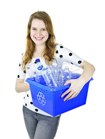 recycling bottles: Smiling young woman holding full recycling box isolated on white Stock Photo