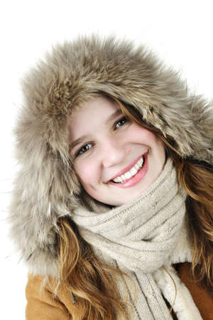 Beautiful young woman in fur hood of winter coat on white background photo