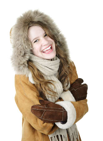 Playful young woman in winter coat on white background photo