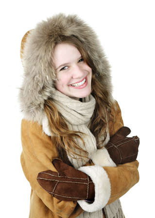 Cozy smiling young woman in winter coat on white background photo