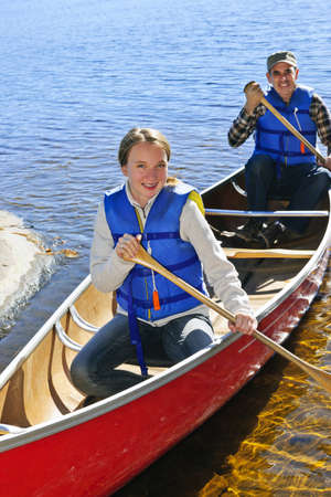 canoeing: Father and daughter canoeing on Lake of Two Rivers, Ontario, Canada Stock Photo