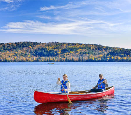 lifejacket: Father and daughter canoeing on Lake of Two Rivers, Ontario, Canada Stock Photo
