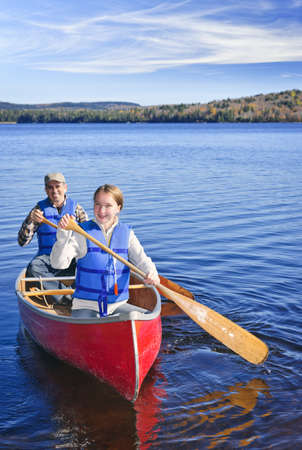 safety jacket: Father and daughter canoeing on Lake of Two Rivers, Ontario, Canada Stock Photo