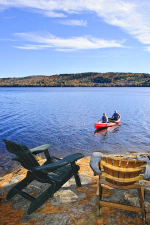 People returning from canoe trip on Lake of Two Rivers, Ontario, Canada photo