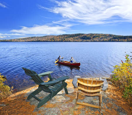 return trip: People returning from canoe trip on Lake of Two Rivers, Ontario, Canada Stock Photo