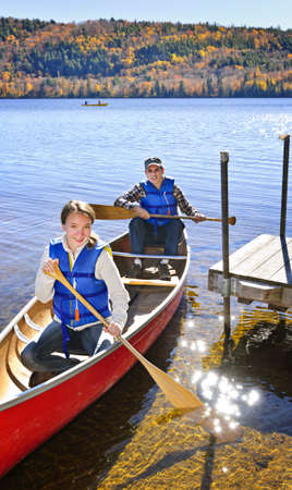 Father and daughter canoeing on Lake of Two Rivers, Ontario, Canada photo