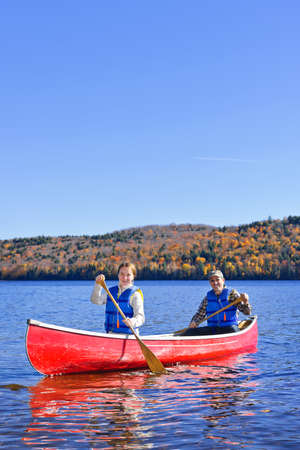 Family canoeing on Lake of Two Rivers, Ontario, Canada photo