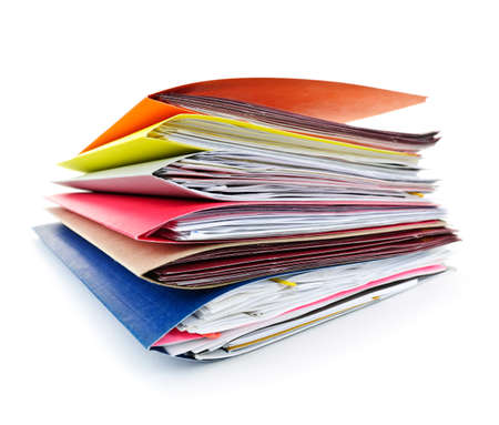 organizing: Stack of colorful file folders with papers on white background