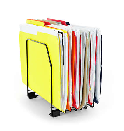 archiving: File folders with documents in vertical organizer