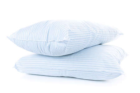 Two soft pillows with blue striped covers isolated on white background Stock Photo