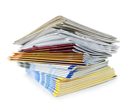 Printed paper publications stacked in a pile isolated on white photo