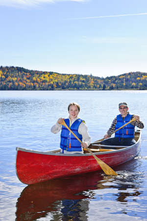 boating: Father and daughter canoeing on Lake of Two Rivers, Ontario, Canada Stock Photo