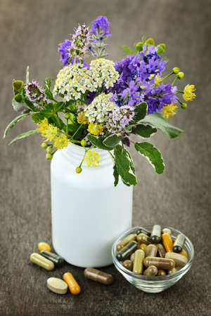 remedies: Herb plants with mix of alternative medicine herbal supplements and pills