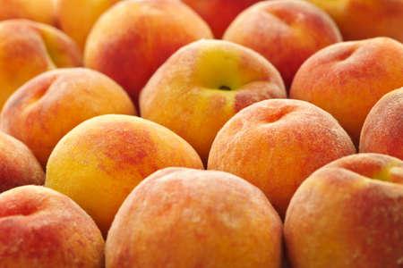 RIPE peaches fraîches comme toile de fond de près