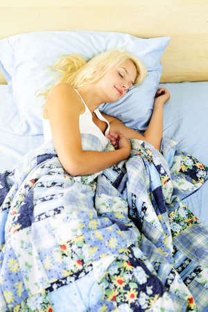 Young woman peacefully asleep in bed in the morning Stock Photo - 10637548