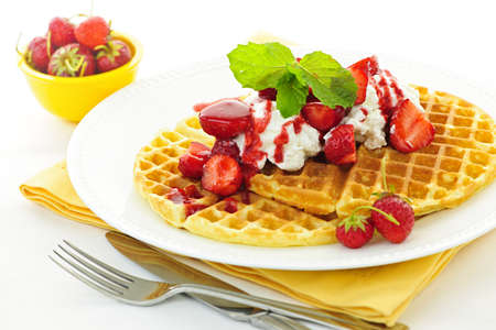 waffle: Plate of belgian waffles with fresh strawberries and whipped cream Stock Photo