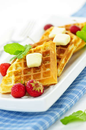 Plate of belgian waffles with fresh strawberries and pats of butter Stock Photo - 10637546