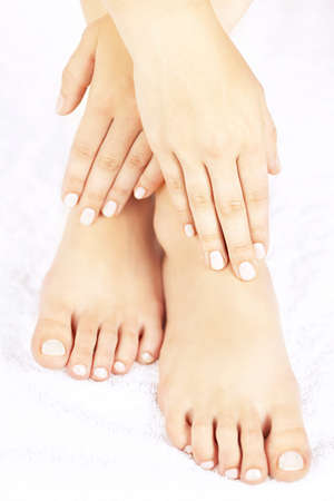 Soft female feet and hands with pedicure and manicure photo