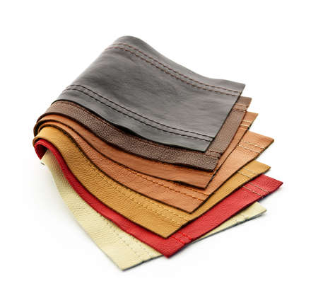Leather upholstery samples with stitching in various colors isolated photo