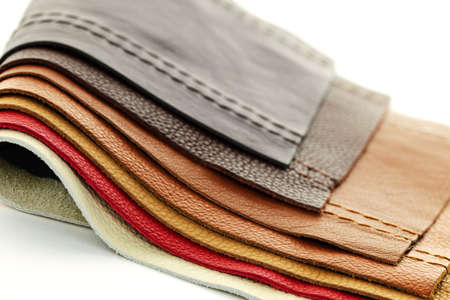 Natural leather upholstery samples with stitching in various colors photo
