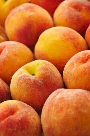 Ripe fresh peaches as background close up photo