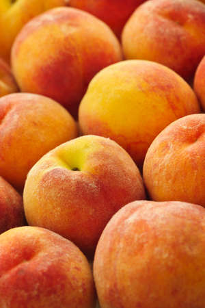 Ripe fresh peaches as background close up