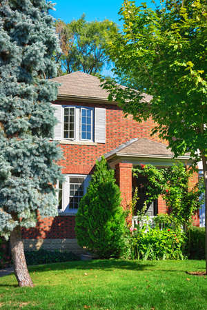 City home in red brick exterior with garden Stock Photo - 10905673